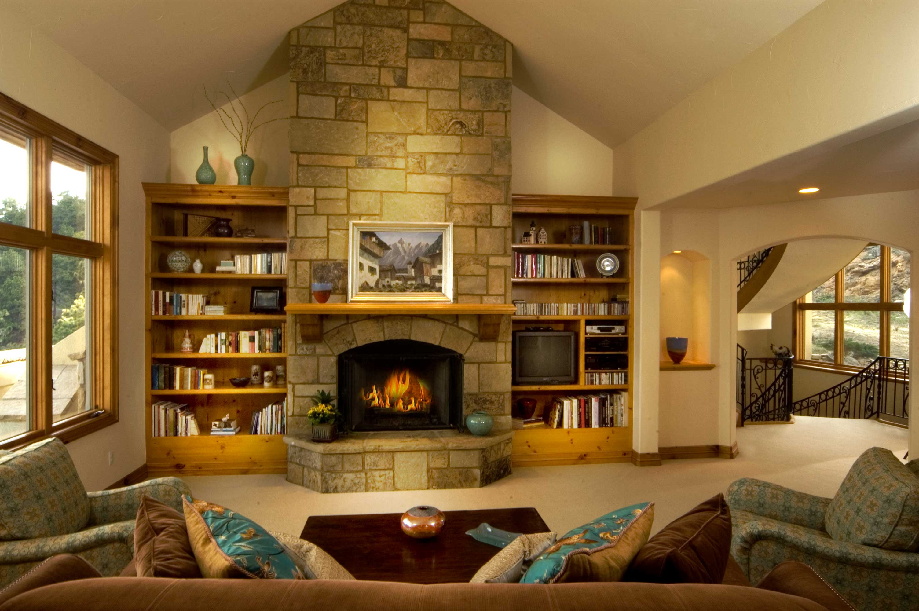 rustic-family-room-with-bookcase_living-room-with-fireplace-and-tv ...
